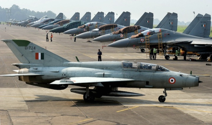 An Indian Air Force (IAF) MIG-21 passes near Sukhoi-30 fighter jets before a drill for Air Force Day celebrations in Kalikunda IAF airbase around 170 km west of Kolkata on September 29, 2011. Indian Air Force Day is celebrated on October 8 each year. AFP PHOTO/ Dibyangshu SARKAR (Photo credit should read DIBYANGSHU SARKAR/AFP/Getty Images)