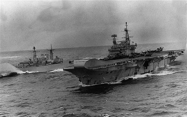 Falklands War The carrier HMS Hermes ploughing through heavy seas flankeed by HMS Broadsword