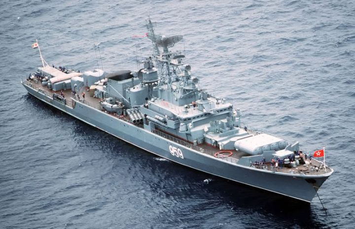 An aerial starboard bow view of the Soviet Krivak I Class guided missile frigate 959 at anchor.
